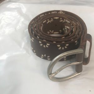 Brown leather belt with white threaded accent